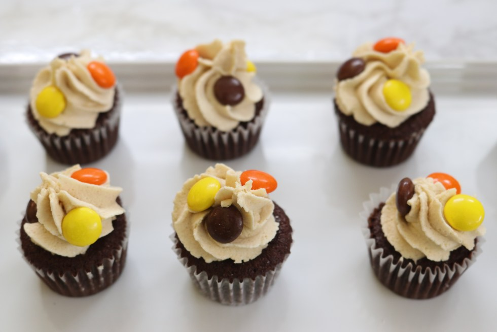 Mini Chocolate cupcakes with peanut butter icing and Reese's Pieces