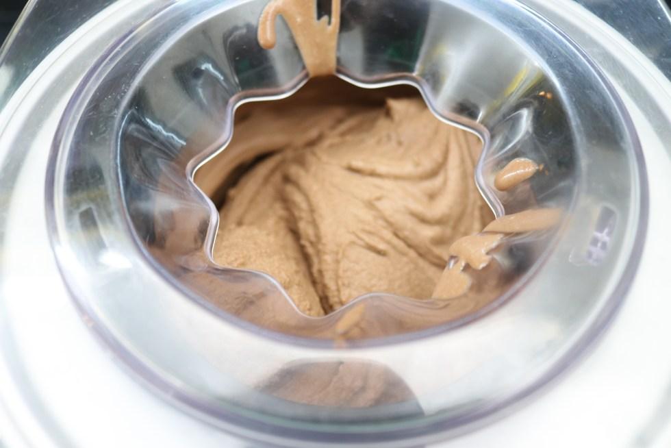 Chocolate ice cream being made in ice cream machine