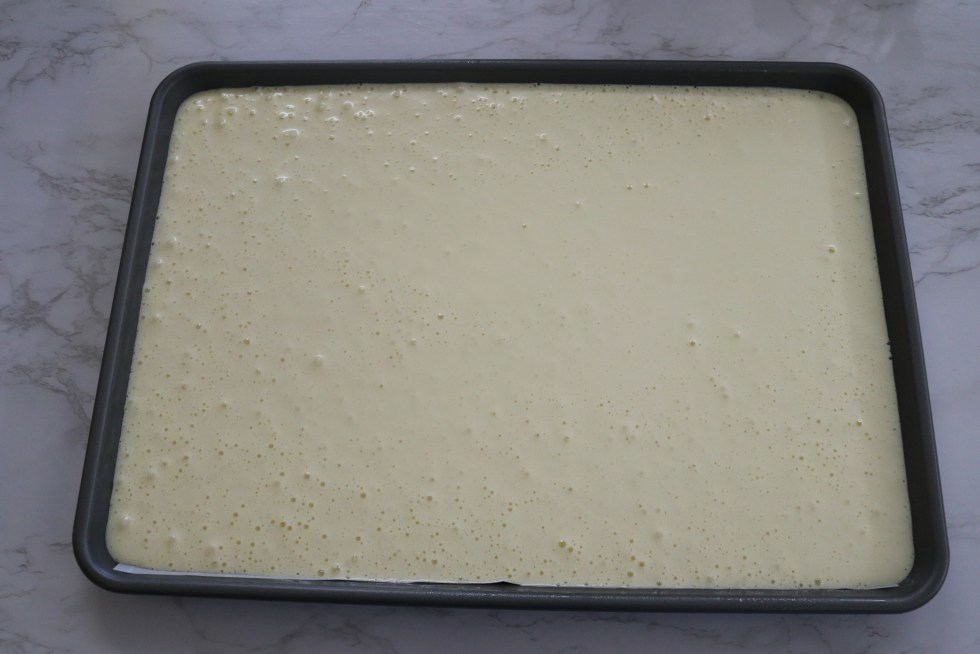 Pouring cake mixture into prepared pan