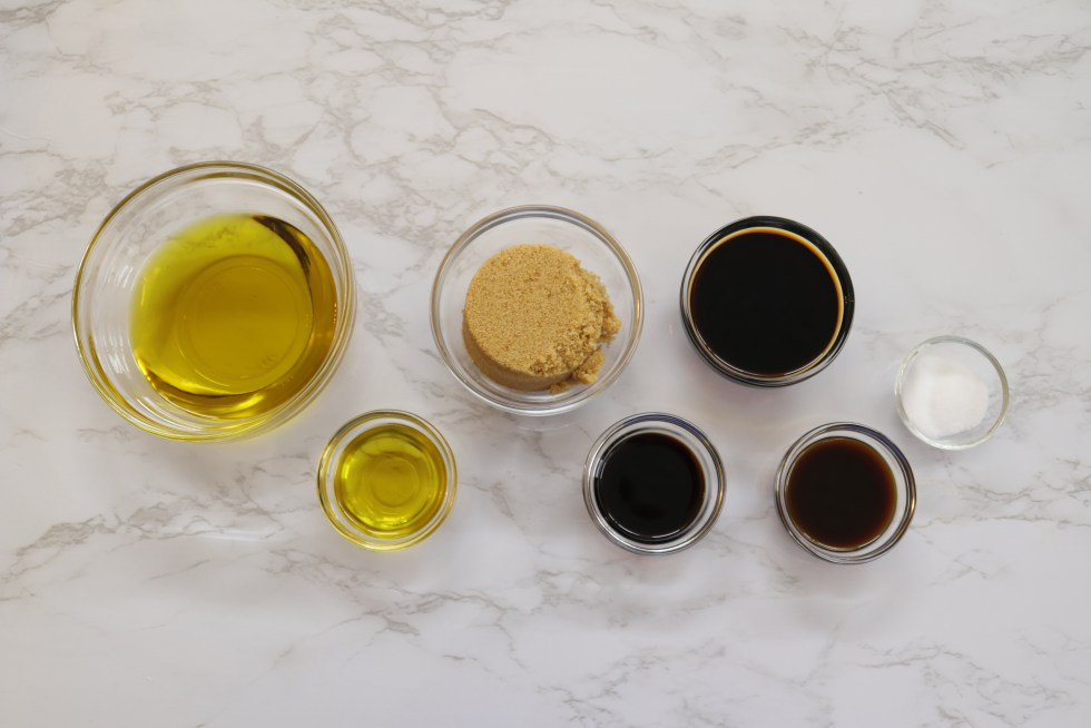 Small clear bowls of ingredients for grilled chicken marinade