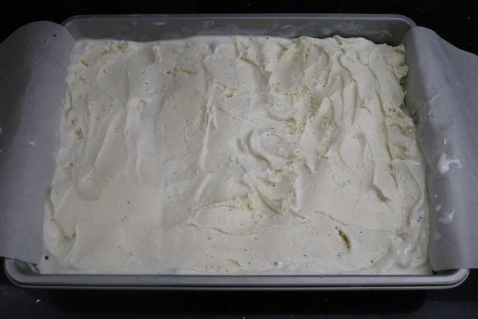 Vanilla ice cream spread in a baking pan
