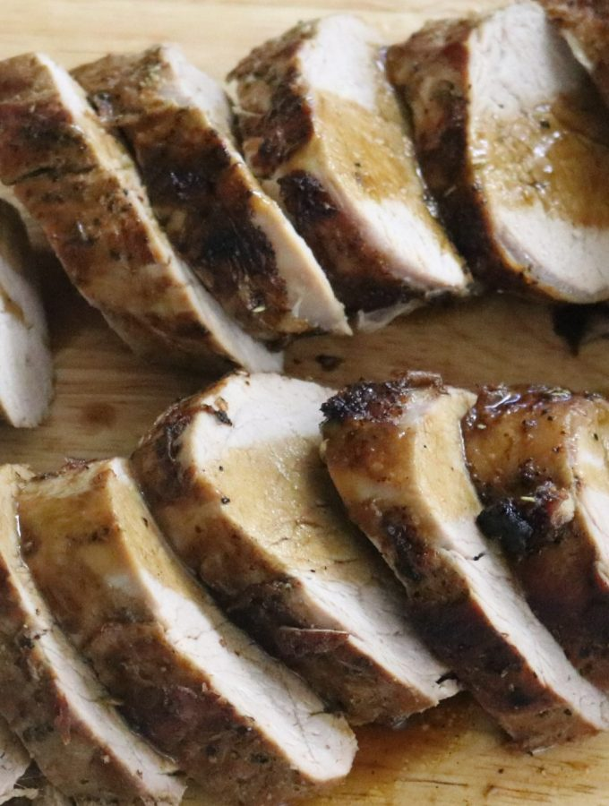 Pork tenderloin on a board