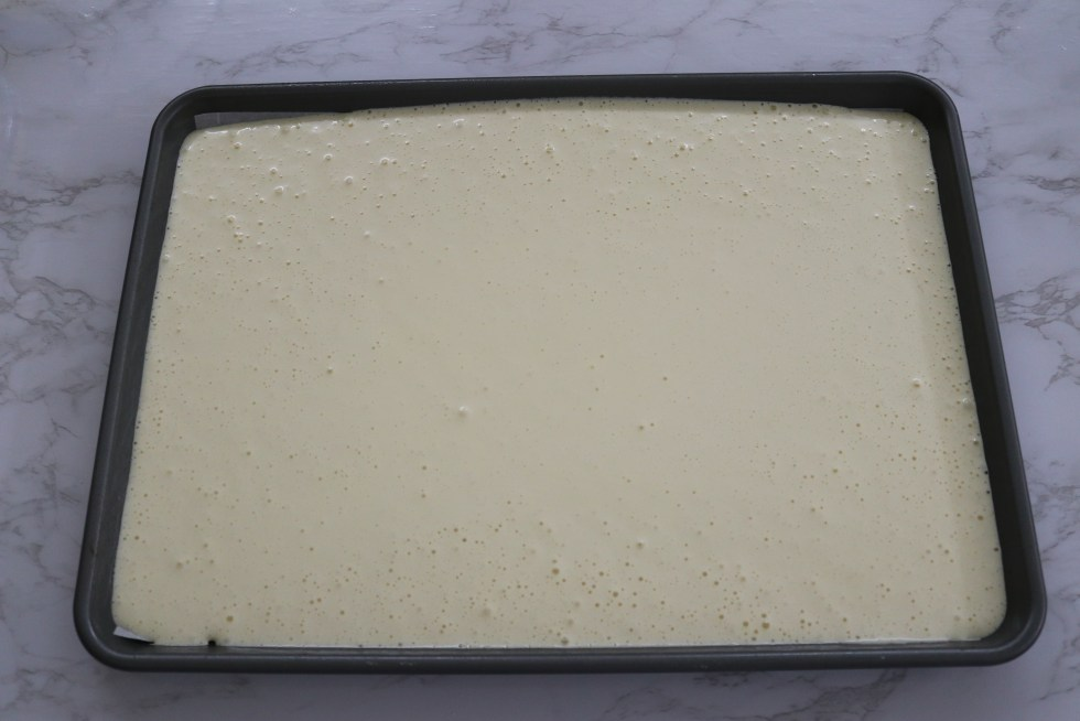 Vanilla cake batter  in a sheet pan