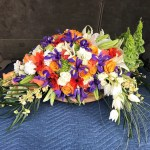 Casket Spray in Orange/Purple