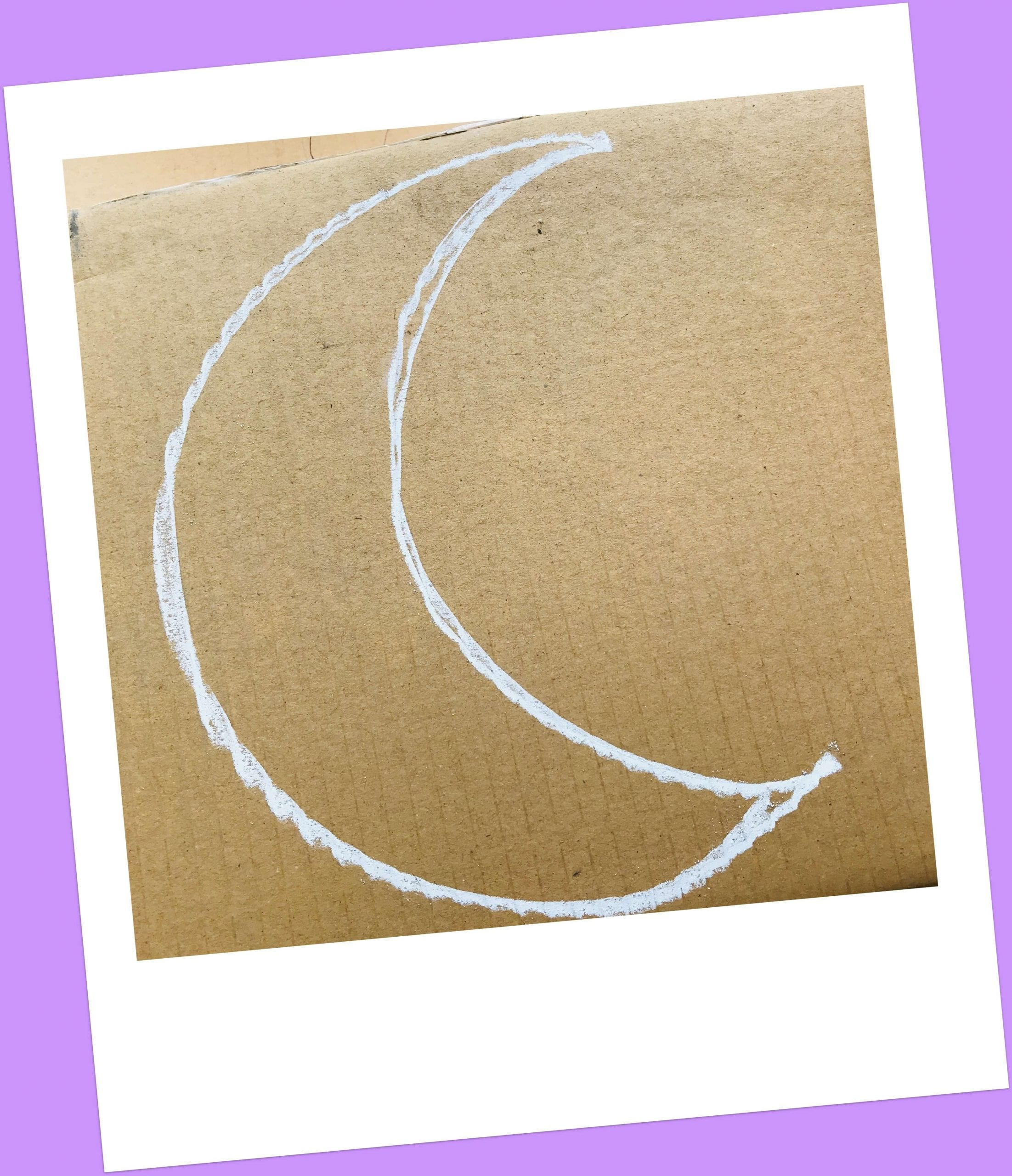 moon drawn on cardboard