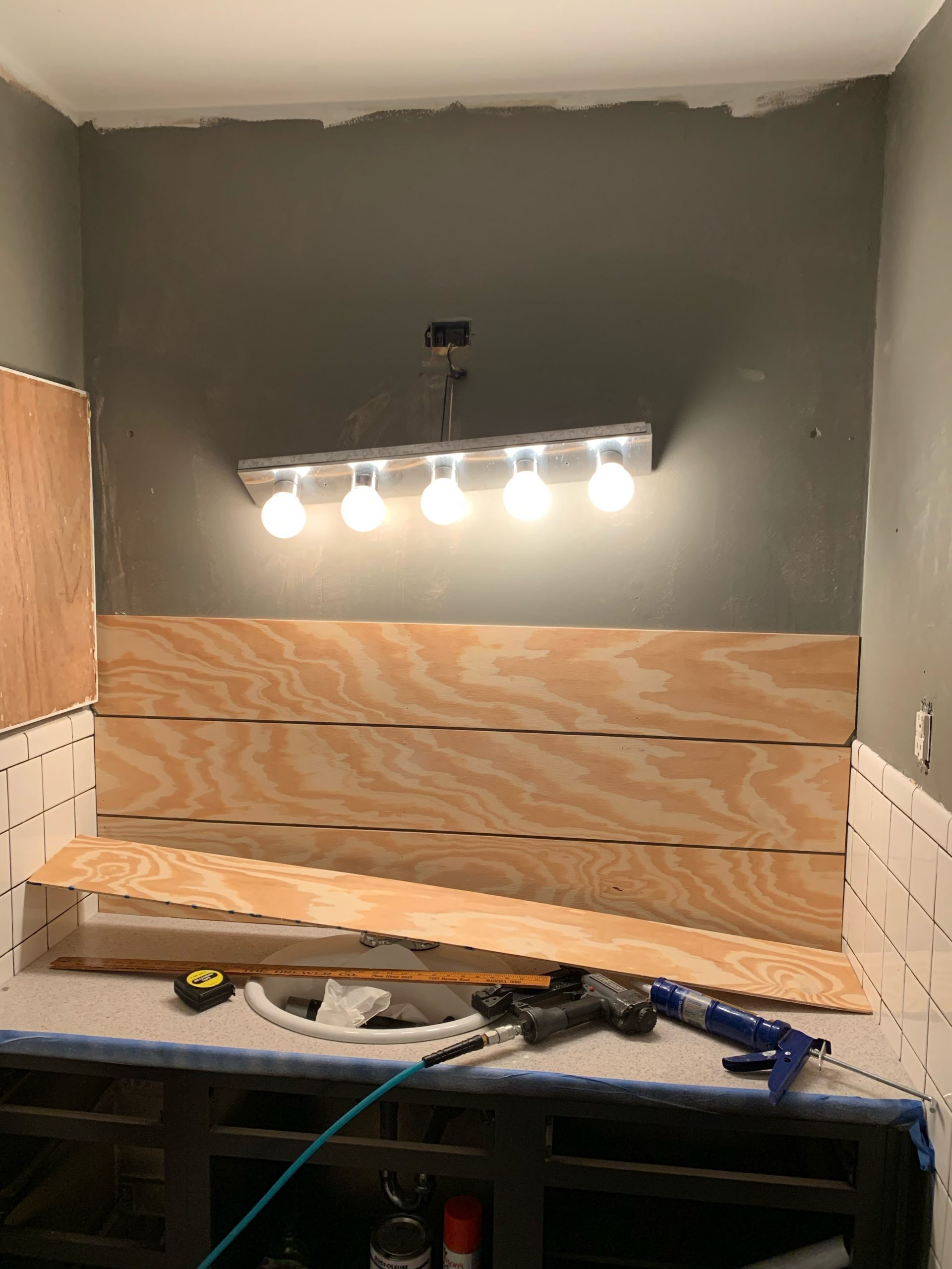 building our shiplap wall in bathroom