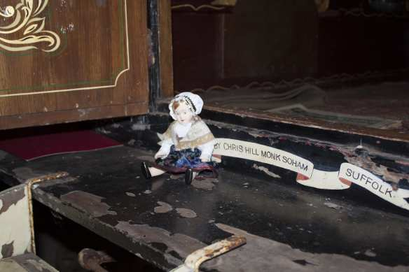 The doll that sits on the step of the haunted vardo