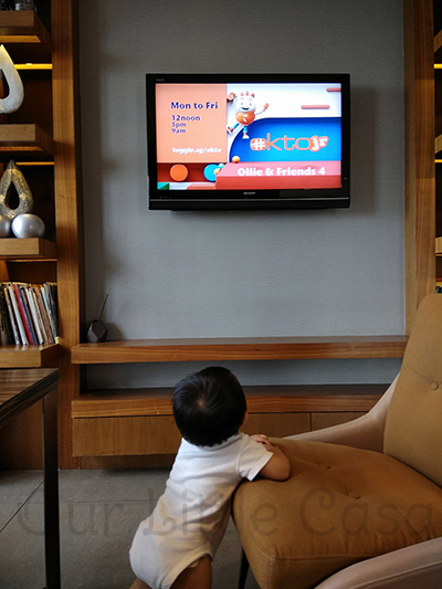 Baby J Watching Okto Cartoons in the Club Lounge