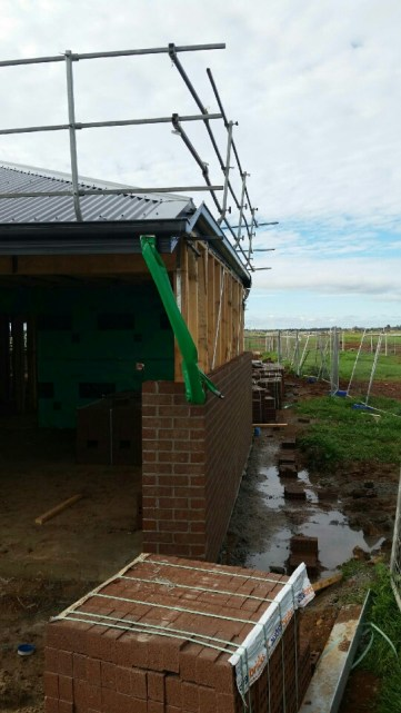 The garage boundary wall with bricks in progress