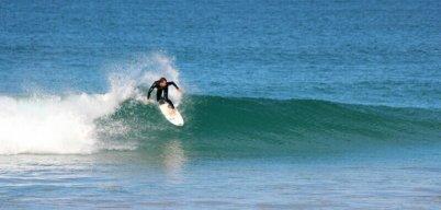 Watching surfers at Matauri Bay