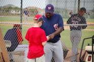 Dimitri Young signing an autograph at Spring Training in 2009