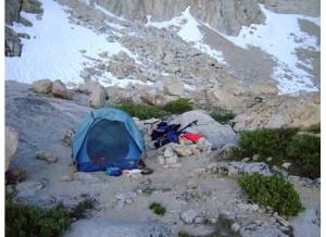 A backpacking setup includes ultralight sleeping and cooking gear, and not much else
