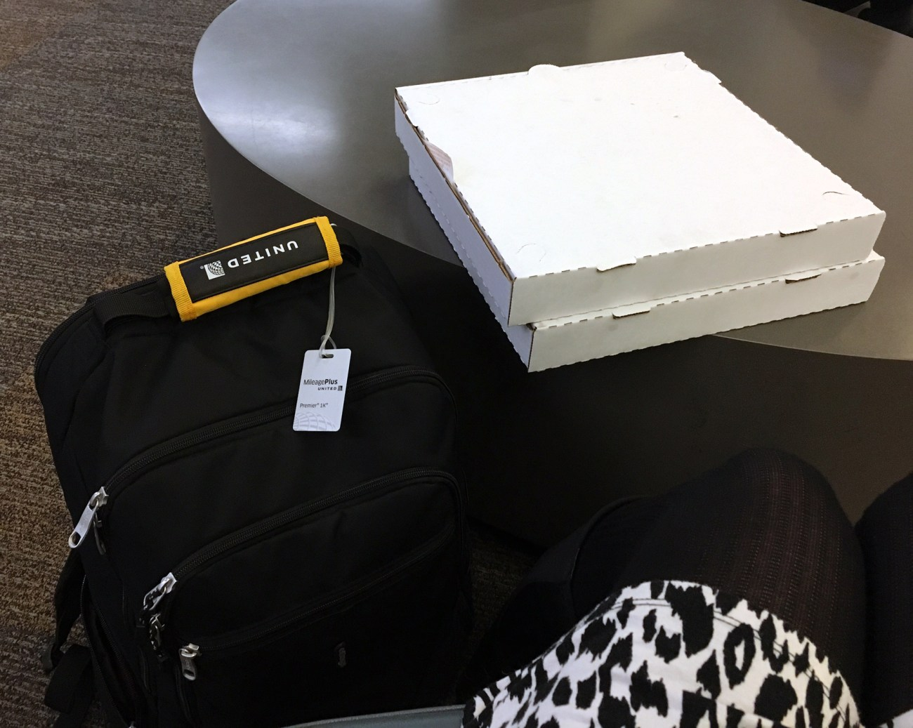 Tanja's carry-on bags, including gluten-free pizza // Our Next Life