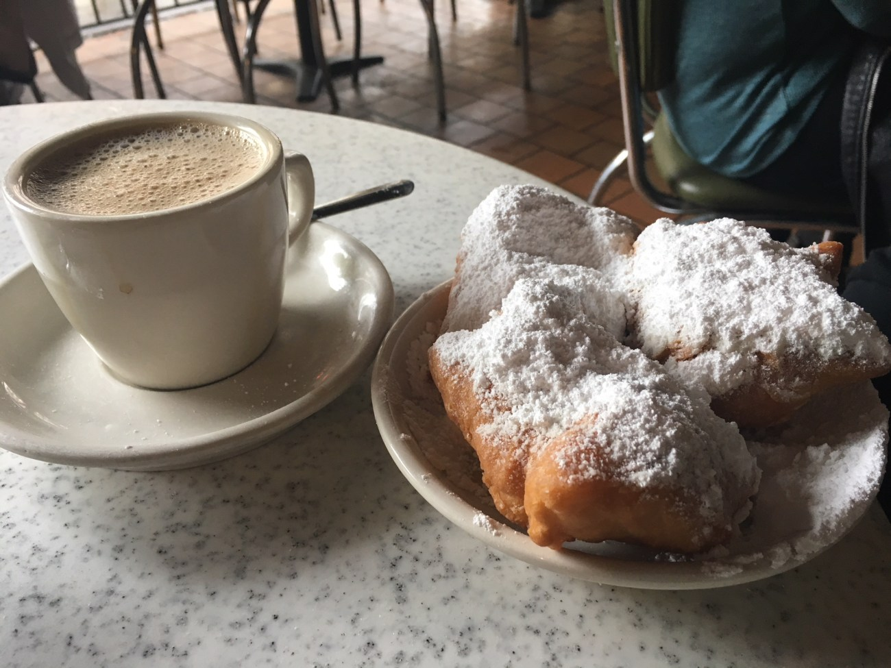 Pic of beignets and cafe au lait at Cafe Du Monde in New Orleans // The Nothing New Year Redux, Celebrating a Year of Less (minimalism, decluttering, simple living, simplicity, intentional living, mindfulness)