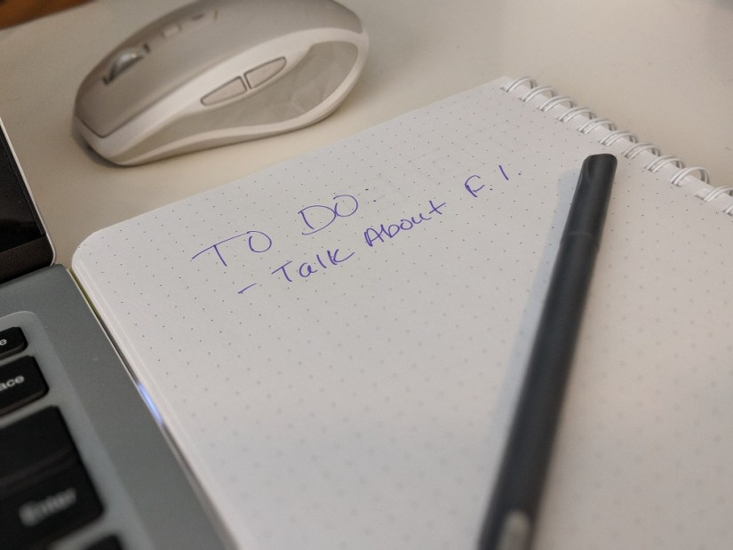 Photo of a notebook with a To Do List that says Talk About FI