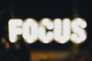 Unfocused photo of word focus in lights
