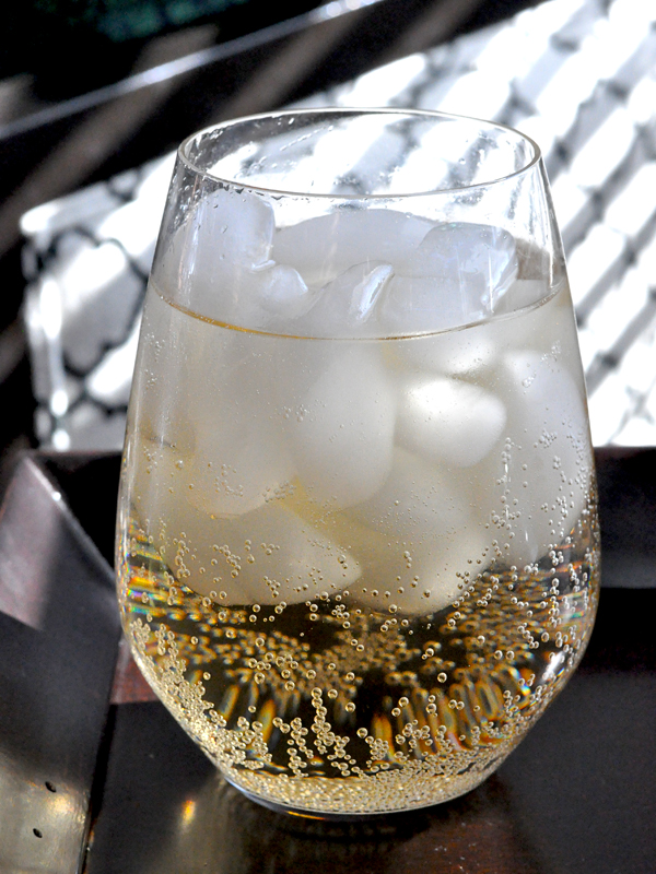 sparkling drinking in glass with ice