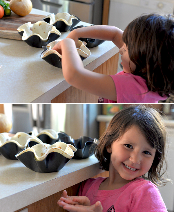kid making taco bowl salad shells