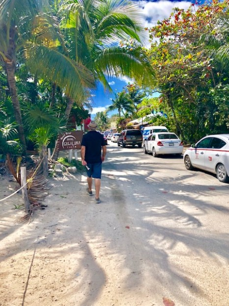 Glenn walks along beach road
