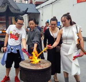 Worshipers lighting incense at Jade Temple Shanghai