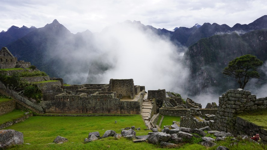 Machu Picchu Peru fog rising over the ruins