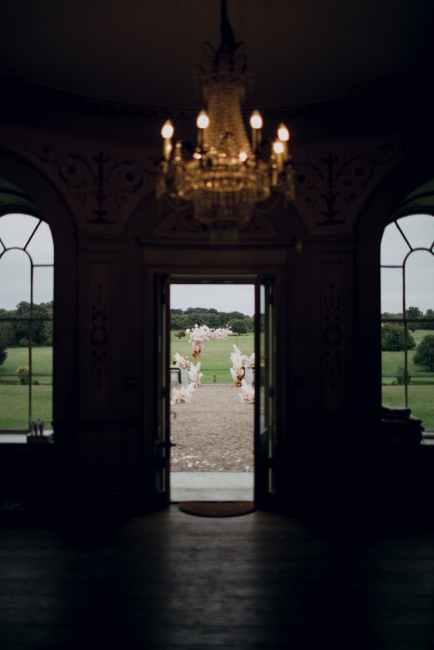 wedding arch through open door good luck superstitions