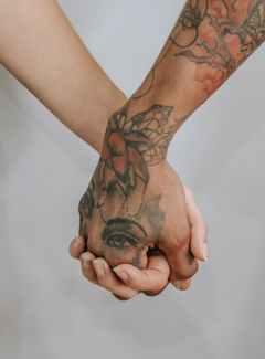 people holding hands together closely Happiness is the harder choice