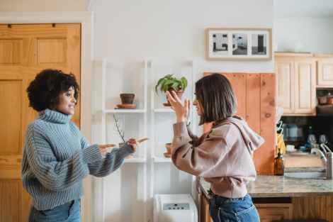 irritated multiracial women fighting in apartment toxic parent