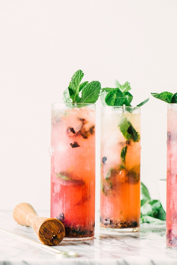 This blueberry mint julep is an easy, seasonal, and fun twist on the classic summer cocktail that's almost too pretty to drink - almost.