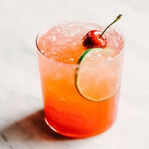 This Cherry Gin Rickey cocktail is liquid summer. It's tart and refreshing with the perfect amount of sweet. You can easily make a large batch, so grab a few friends and get your rickey on. #cocktail #cherry #summer