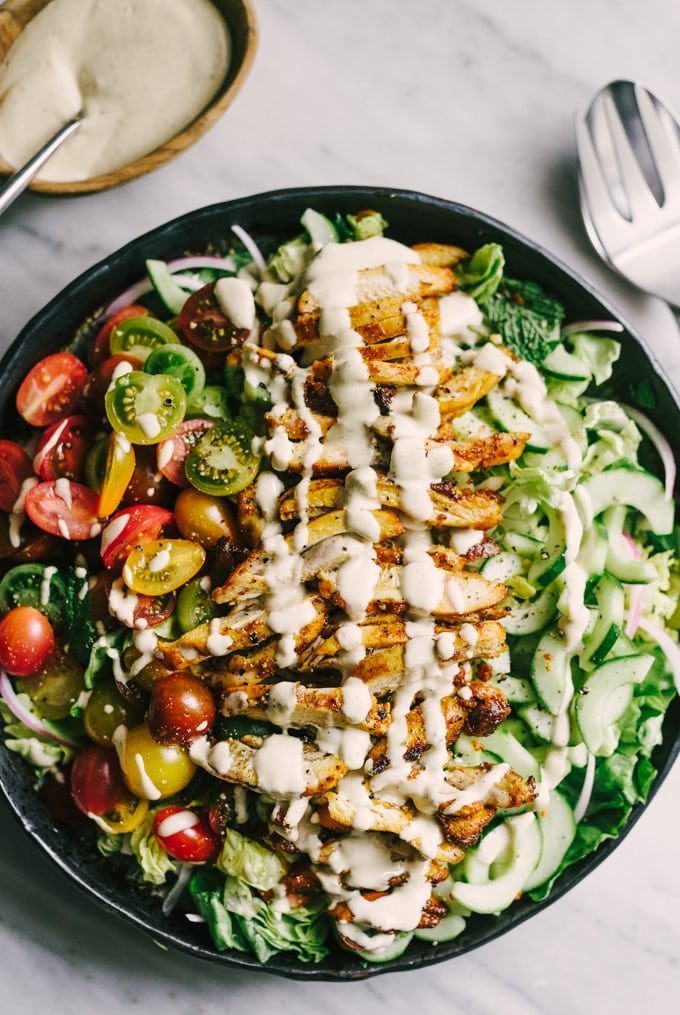 Chicken shawarma salad is an incredibly flavorful, fresh, and elegant weeknight paleo dinner. Each bite is crisp, bright and bursting with flavor. The marinade takes just minutes and can be prepped the night before, making for an easy and fast dinner. #paleo #dinner #realfood #wholefood #whole30