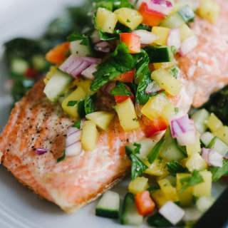 This fresh and tangy cucumber mango salsa is one of my favorite toppings for simple pan-seared wild salmon. It's a fast and easy whole foods recipe that is packed with colorful, seasonal vegetables. Now that's what I call an easy, weeknight real food dinner! #healthy #wholefood #realfood #paleo #whole30