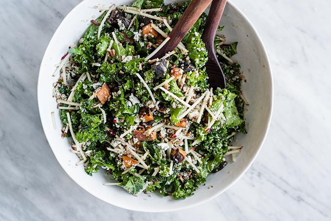 This kale chicken salad is the quintessential recipe for a fall harvest salad. It's made with super crispy apples, kale, grilled apple cider chicken, and warm potatoes, then dressed with a sweet and tart maple cider vinaigrette. It's an easy, fast, and deeply nutritious weeknight autumn dinner. #wholefood #realfood #healthy #glutenfree #fall #salad