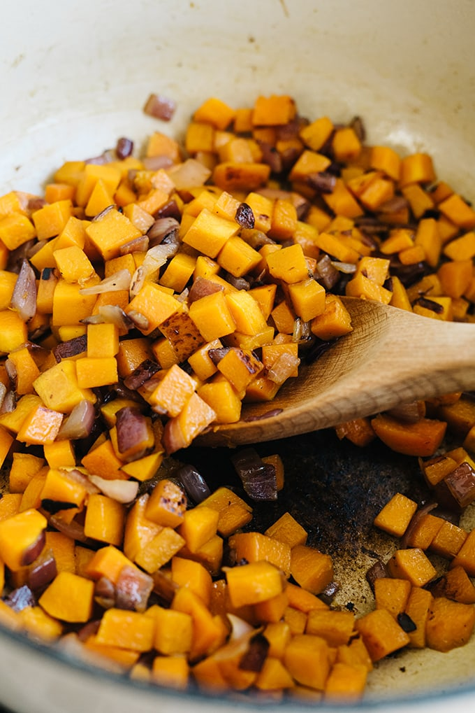 How to prepare butternut squash rice pilaf. Sauté red onions with caramelized butternut squash in a dutch oven.