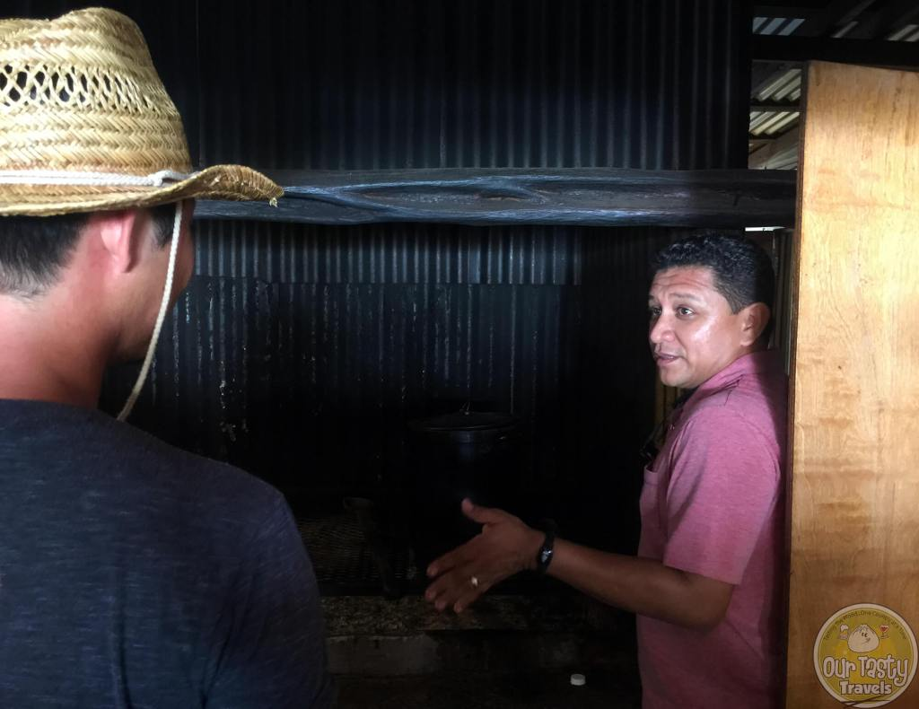 Luis from El Fogon sharing how the open hearth oven works in Belizean cooking