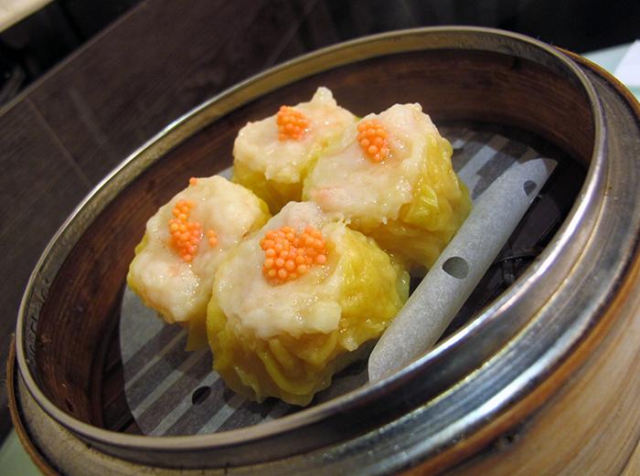 Pork Dumplings with Crab Roe (Siu Mai) http://ourtastytravels.com/blog/dimdimsum-dim-sum-hong-kong/ #dimsum #hongkong #ourtastytravels