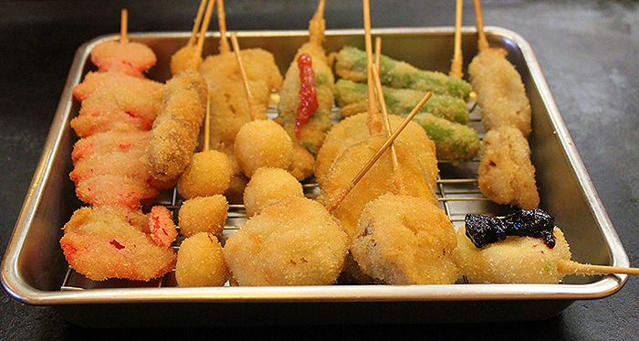 A variety of Kushikatsu skewers  http://ourtastytravels.com/blog/street-food-eats-kushikatsu-japan/ #japan #food #travel #ourtastytravels