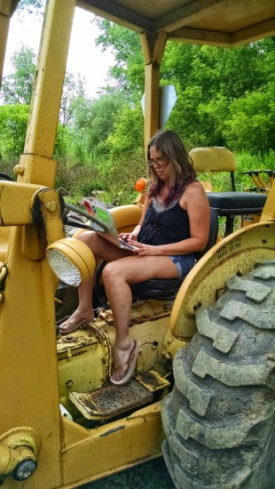 The diesel smell of the tractor keeps the bugs away while I work outdoors.