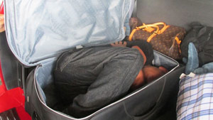 tx_man-hiding-in-suitcase