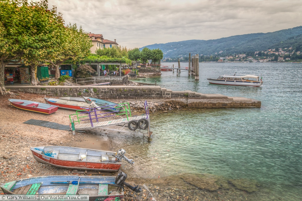 Boats moored up on Isola del Pescatori, Piedmont, Italy
