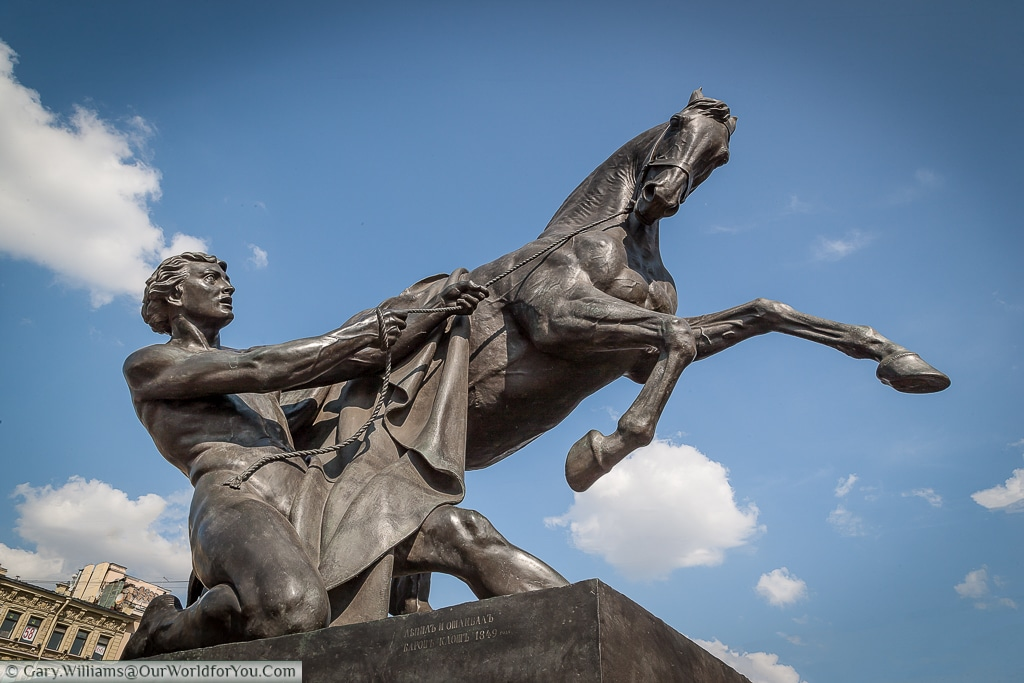 One of the 4 Horse tamer statues over the Anichkov Bridge in St Petersburg Russia.