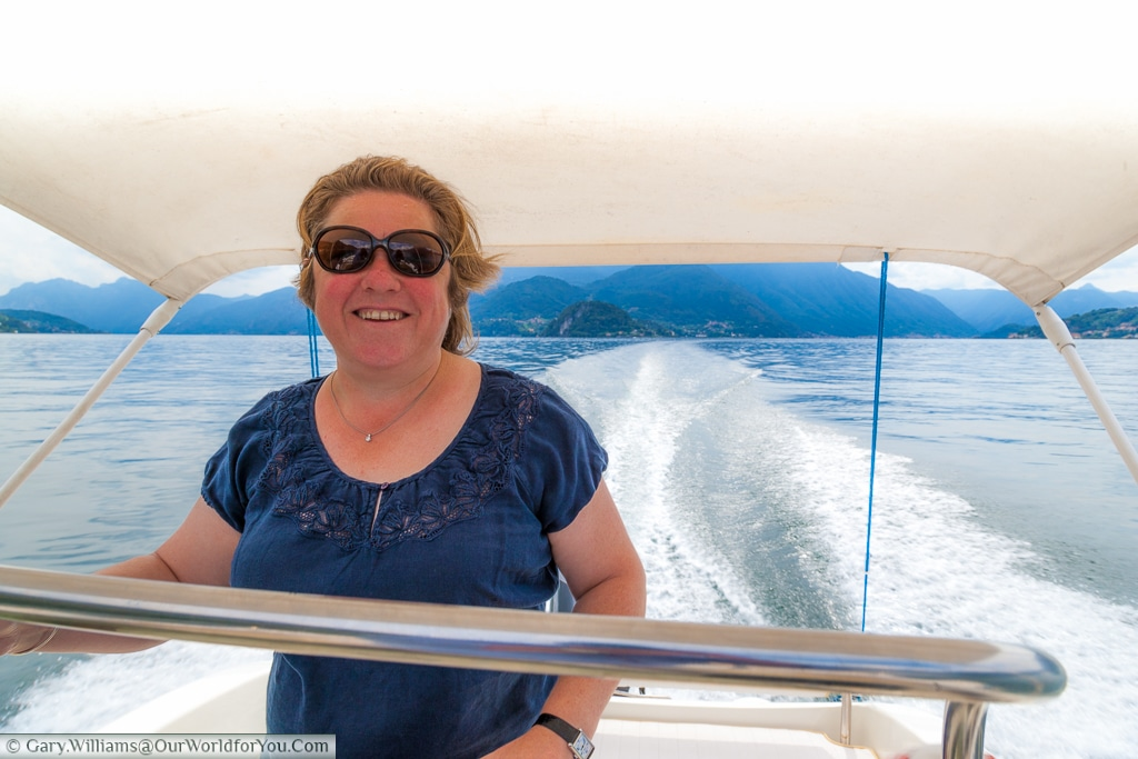 Janis zipping up Lake Como, Italy in a powerboat