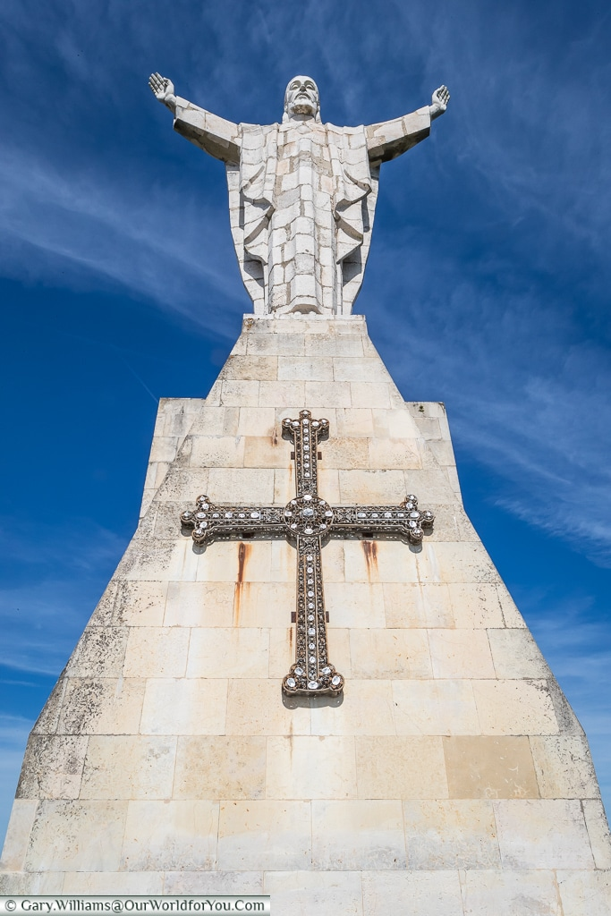 Looking up at the statue of Christ on Mount Naranco, Oviedo, Spain