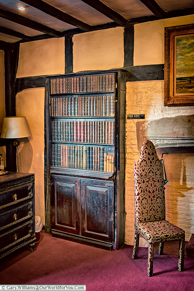 Just a bookcase at the Mermaid Inn, Rye, East Sussex, England, U