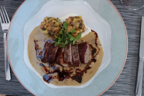 Wild boar saddle with mushrrom sauce and bacon-onion dumplings