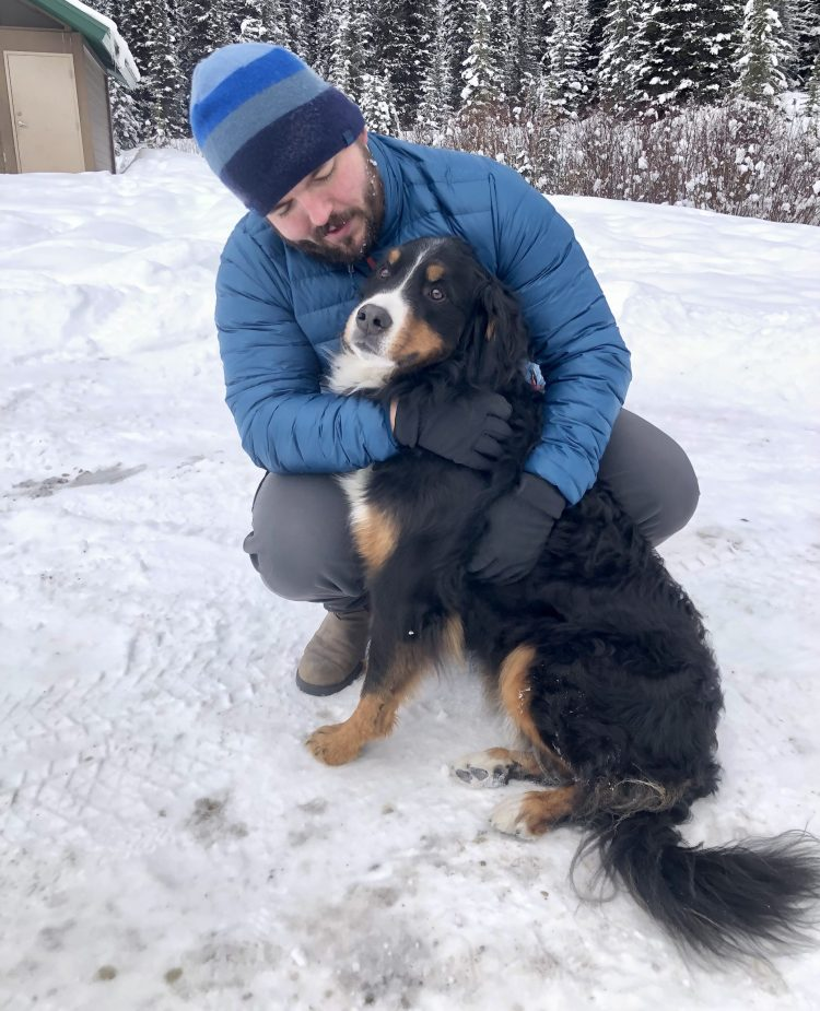 Man and Bernese mountain dog on winter day