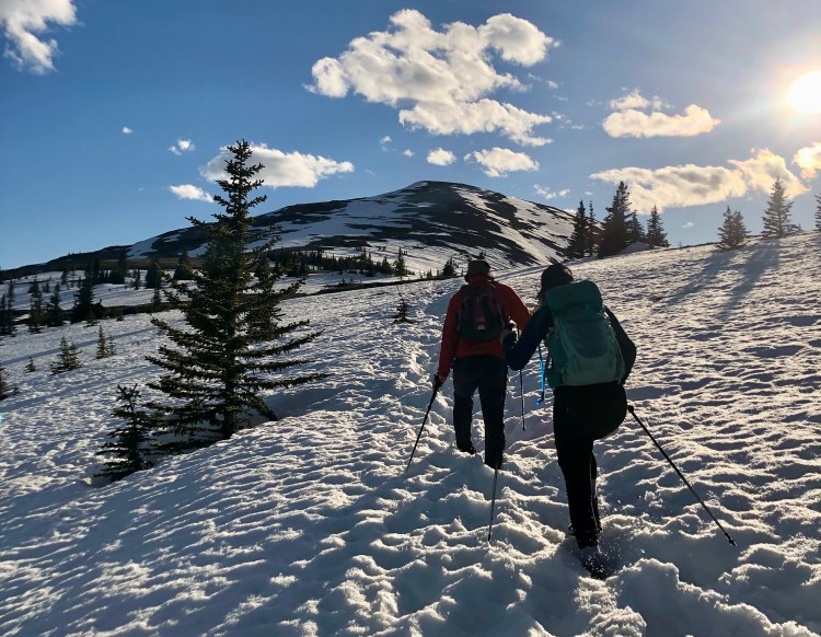 Friends hiking in the snow