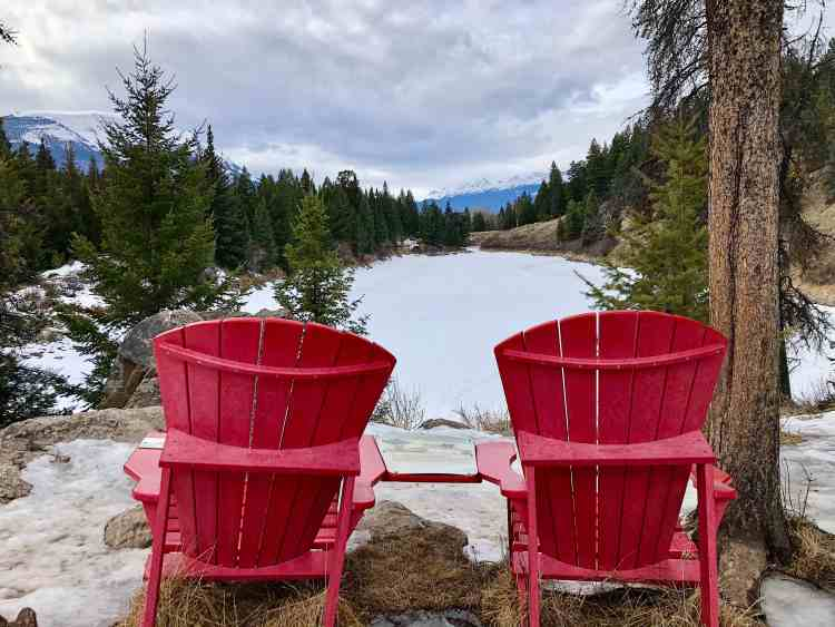 Red chairs at Valley of the Five Lakes hike