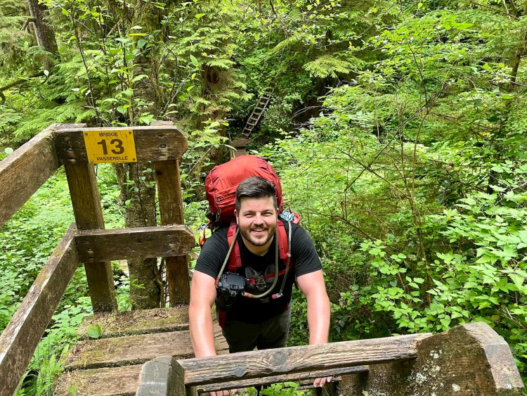 Climbing ladder while hiking the West Coast Trail