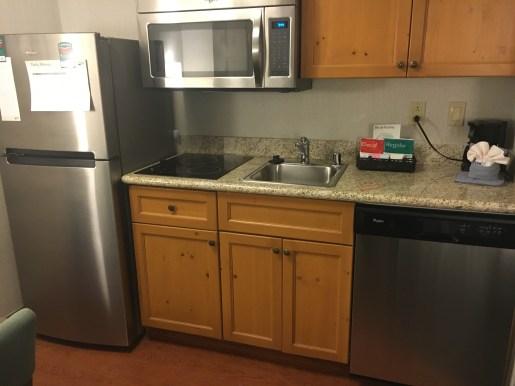 Dishwasher, microwave, coffee area, fridge